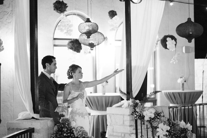 Newly married, greeting guests amid Moroccan hanging garden and floral handrail.  Photo by Jake Holt...