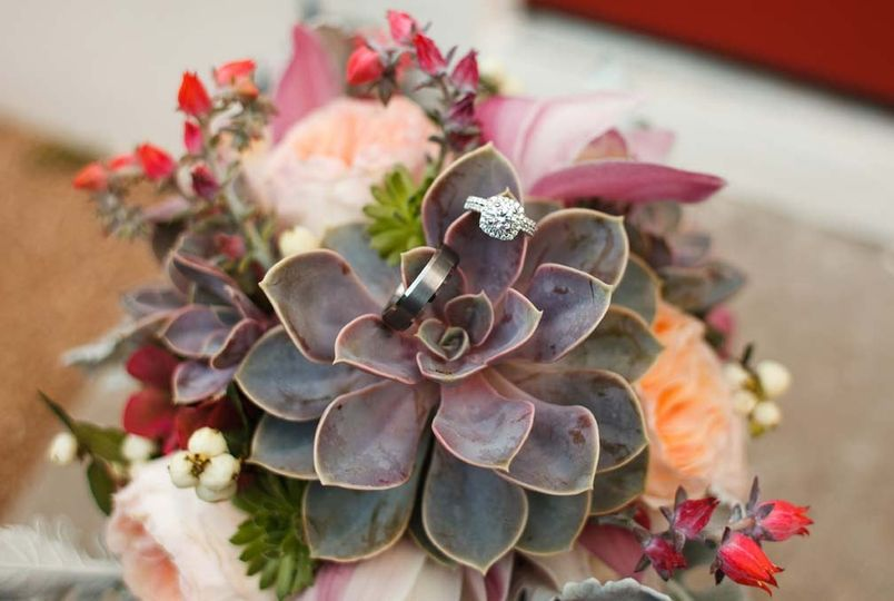 Succulent bouquet with wedding rings on leaves.  Photo by Jake Holt Photography.