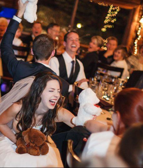 Liz and Nate Photography did a fantastic job capturing the fun moment.  The wedding was at Twin Owls...