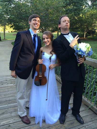 The newlyweds with the violinist