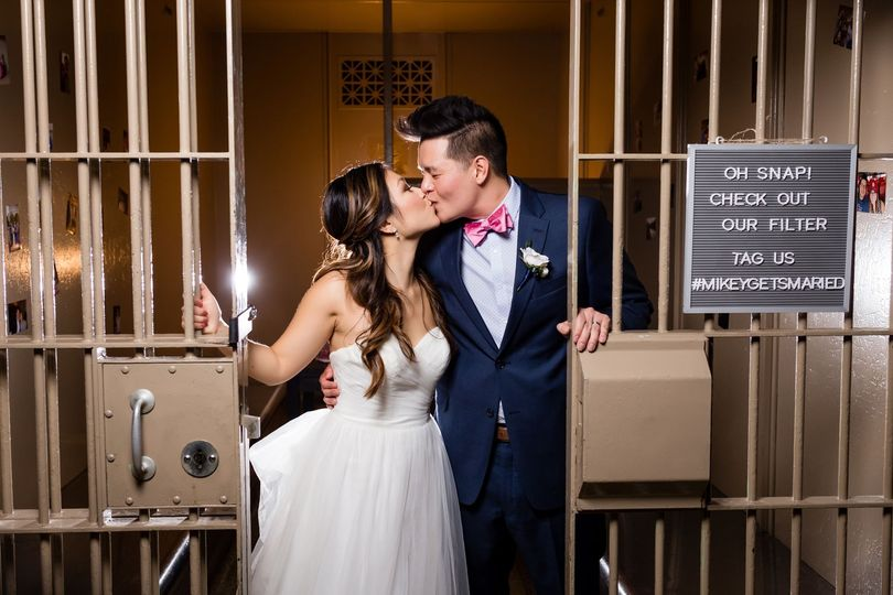 Couple kissing in jail cell