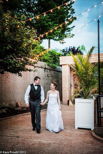 Newlyweds in courtyard