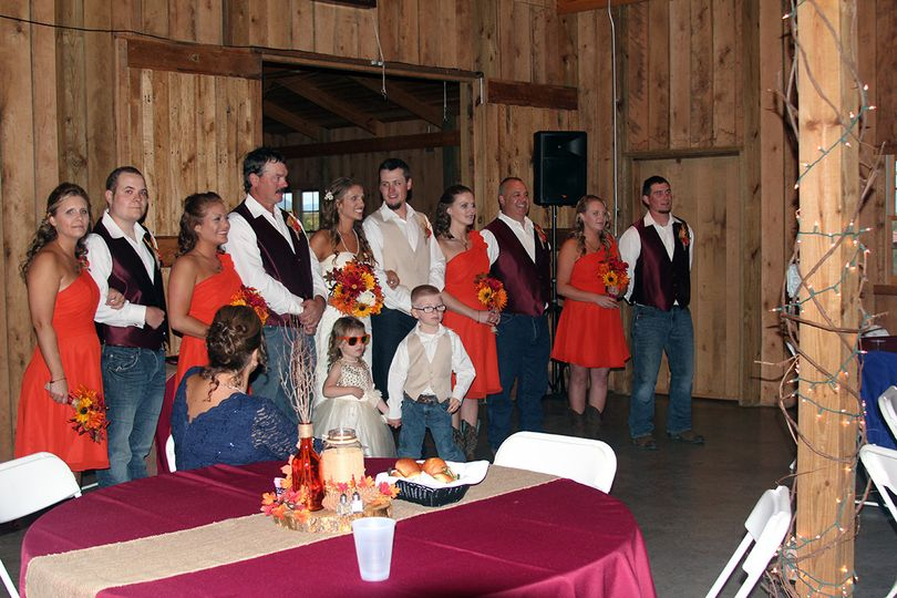 The couple with the bridesmaids, groomsmen and kids