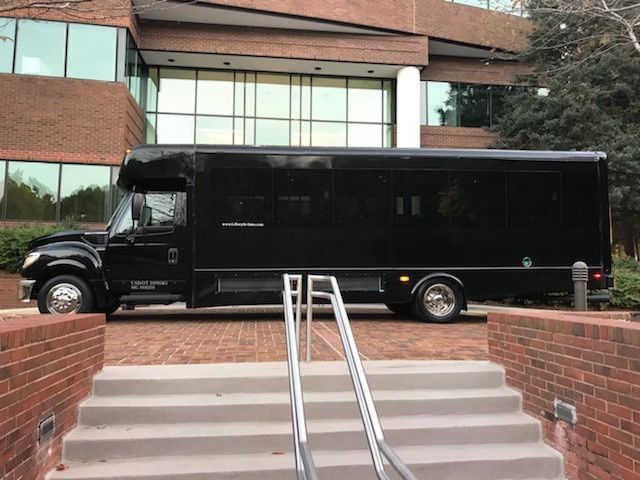 Black Luxury Limo Bus