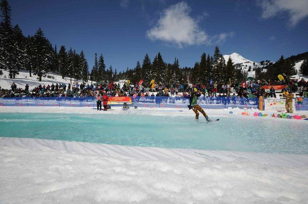 The Sno-Kona Pond Skim is held every April at Meadows, and features 100+ people skimming accross a...