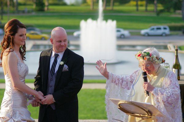 The bride wore pearl satin and they were married at the World's Fair Pavilion in Forest Park.