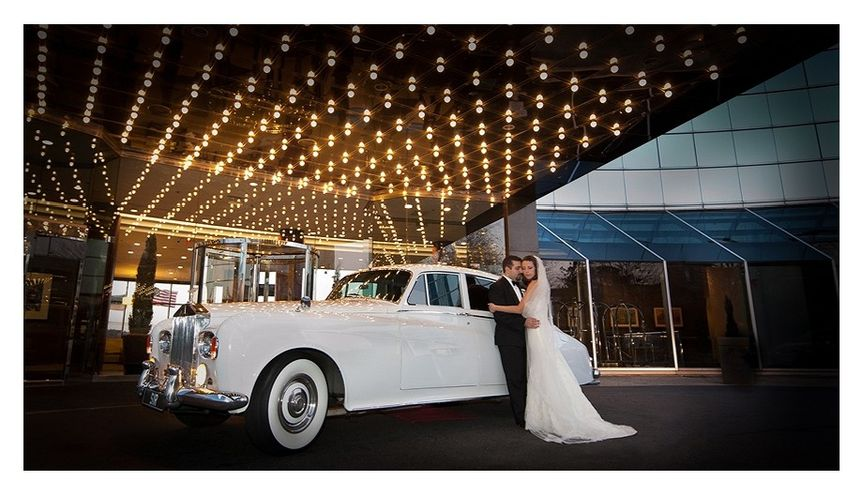 Lovers with their bridal car