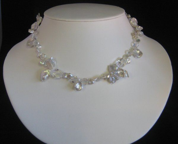 JULIA/$82.- Single strand of textured large and small keishi pearls with faceted crystal quartz and...