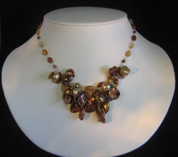 CHAROLETTE/$210.-  Another one of our favorites!  Beautiful shades of brown hessonite garnet create...