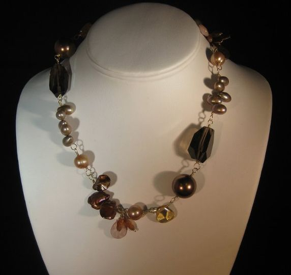 JENNIFER/$156.- An eclectic combination of rich colored brown keishi pearls,bronze shell pearls,...