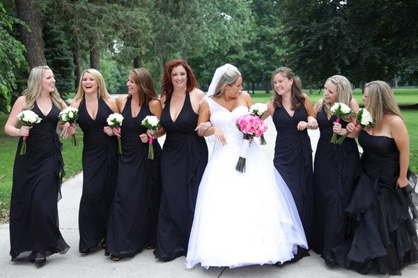The bride takes a moment to have fun in front of the camera with her bridesmaids