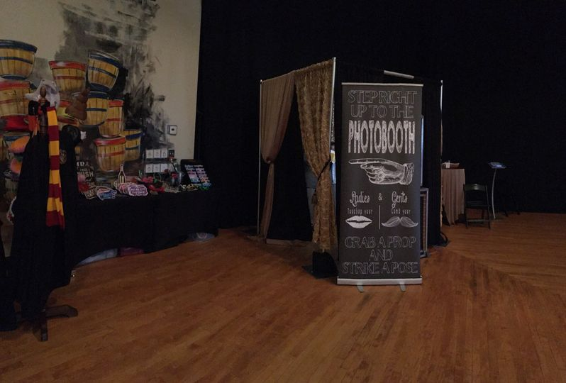 An enclosed photo booth set up and props.