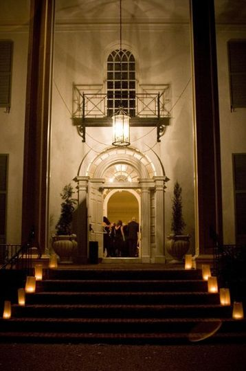 The grand entrance to the mansion at night.