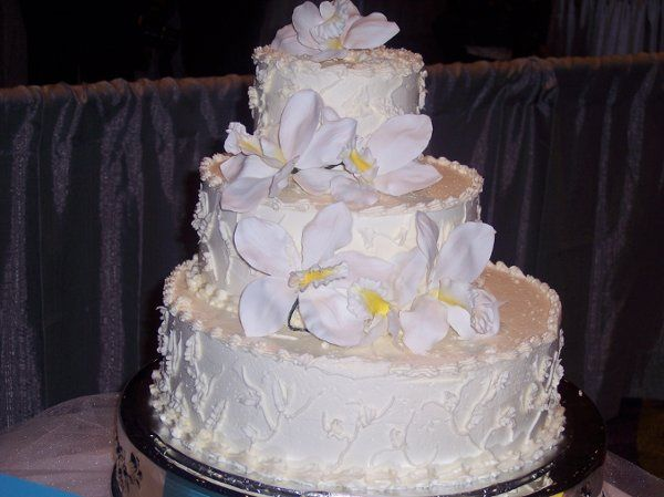 Cake stacked to the back to look like stair steps.