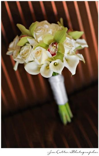 An elegant calla lily, orchid and rose bouquet from a wedding at the Laguna Cliffs Marriott Resort...