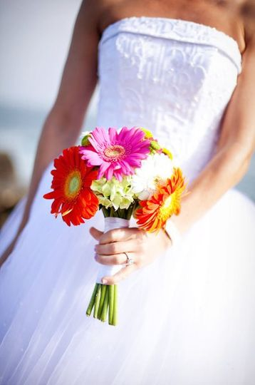 An adorable gerber daisy bridal bouquet from a wedding at St Edwards Catholic Church in Dana Point,...