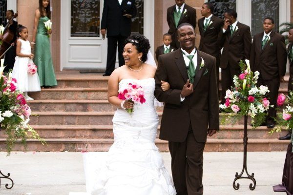 Pink and white flowers perfectly complimented the green dresses and tuxedo accents. Photo by Arika...