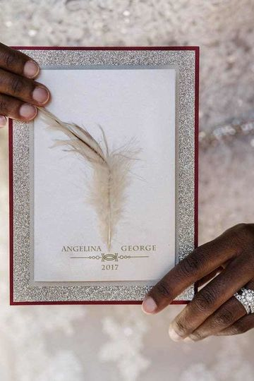 Custom feather four layer side-fold invitation finished with feather