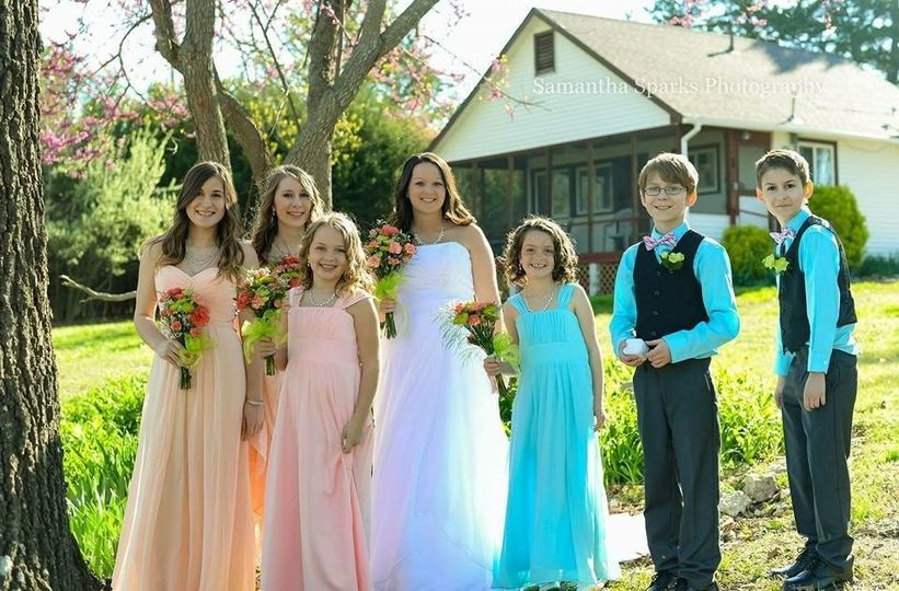 Bride with bridesmaid and groomsmen
