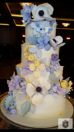 Four tier wedding cake with variety of flowers