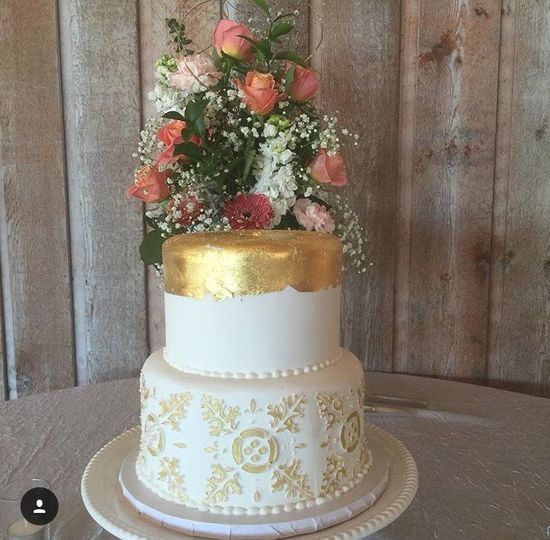 Two tier white and gold cake