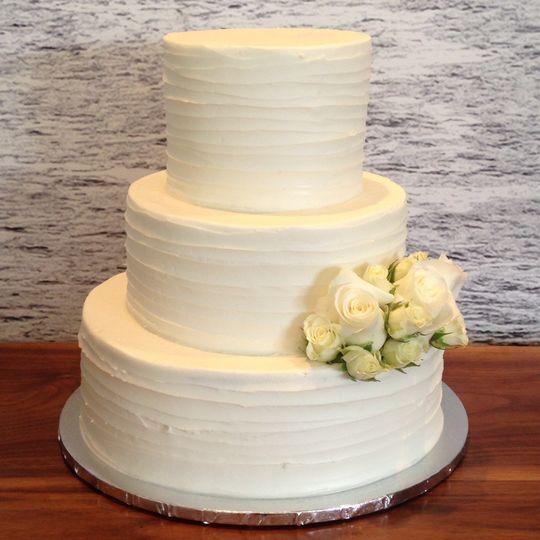 Three tier wedding cake with white flowers