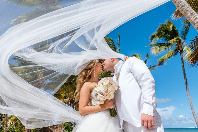Beach wedding by CaribbeanPhot