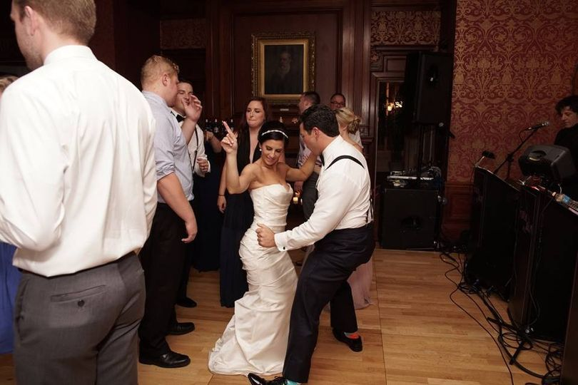 Newlyweds dancing with each other