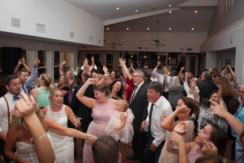 Newlyweds and their guests on the dance floor