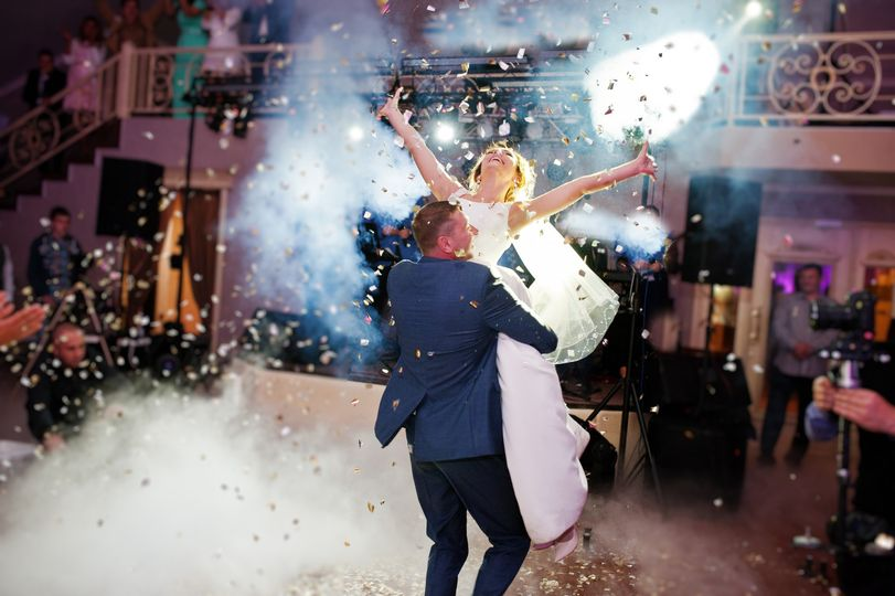 newly married couple dancing on their wedding party with heavy smoke and multicolored lights on the background 1 51 737358 1557971567
