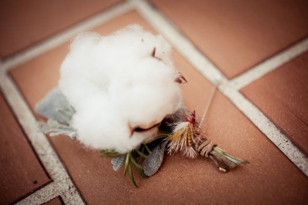 Cotton boll, rosemary, and dusty miller boutonniere with Fly-fishing fly and twine