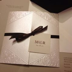 Elegant invite with dark ribbon