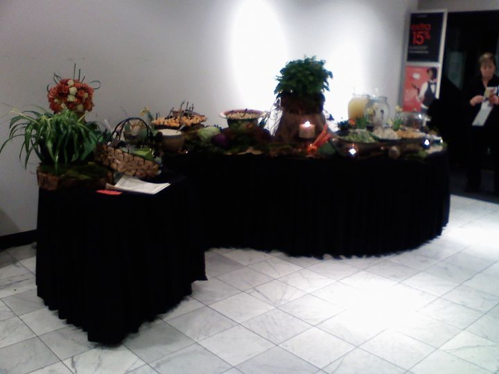 Appetizer display on a serpentine table.