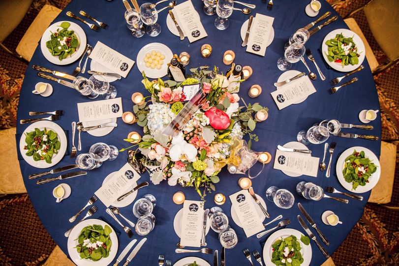 Round table setting and floral centerpiece