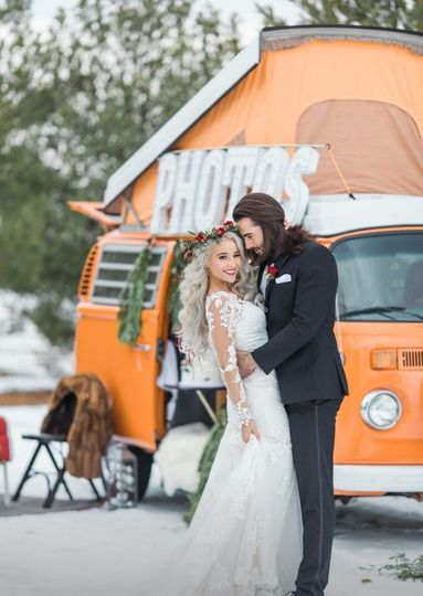 Couple by a photo booth van