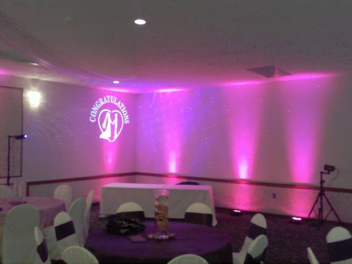 Pink up-lights with monogram