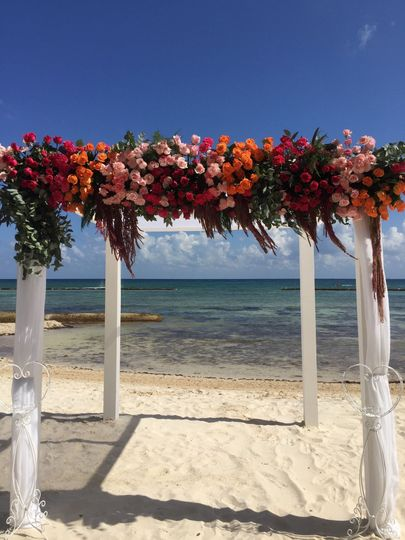 Colors for the ceremony in a white wooden gazebo
