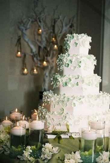 Cake Table Setting with candle tree in background