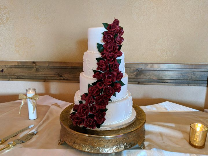 Wedding cake with  dark red roses