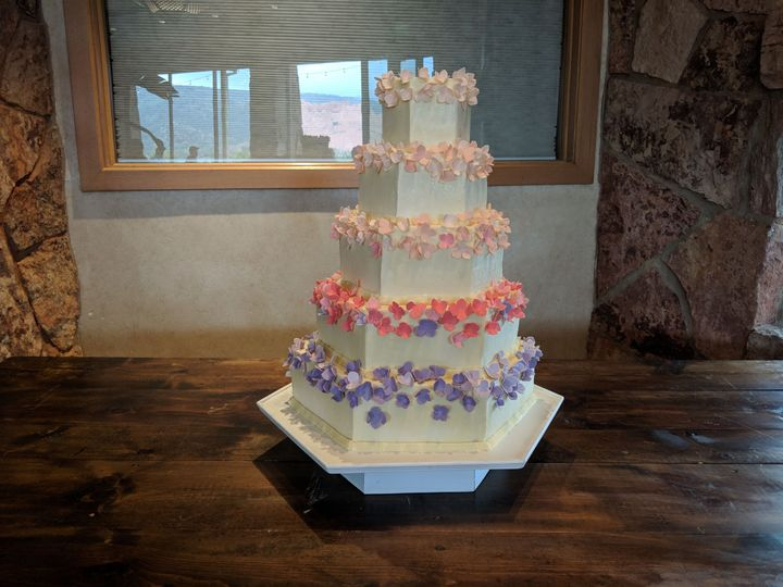 Wedding cake with bits of pastel colors