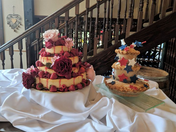 Wedding cake with roses and berries