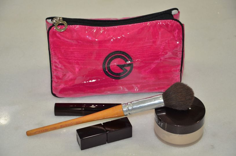 Purse-Make Up.  Small cosmetic case.  Perfectly sized for a purse. 3 interior pockets and ample...