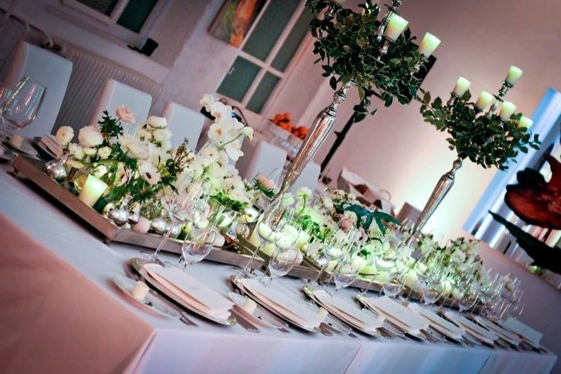 Long table setup with flowers and candles