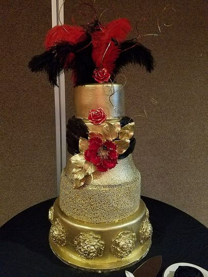 Gold, Black and Red custom designed wedding cake for a New Year's Eve wedding.