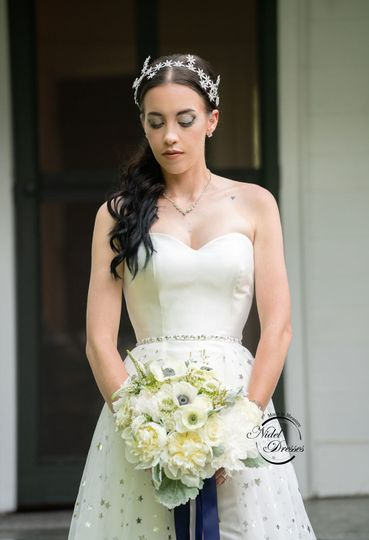 Mikado wedding dress with sweetheart neckline and beaded waistline.