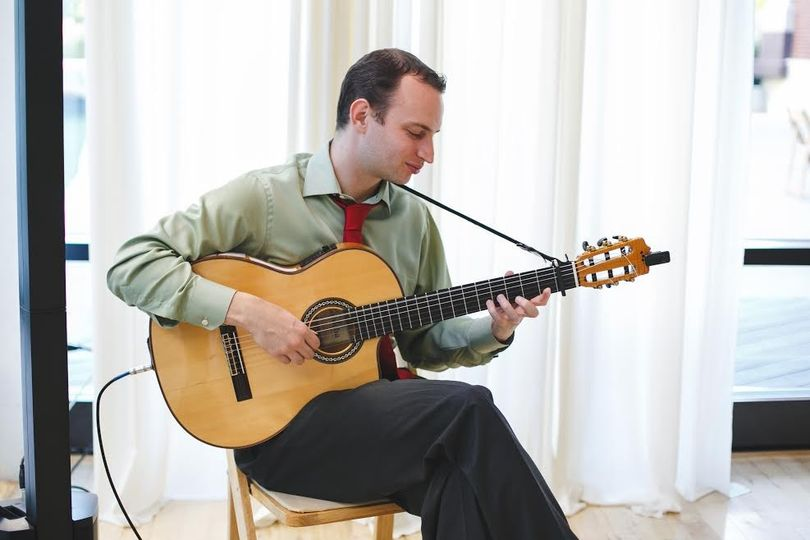 Jim Perona playing his guitar