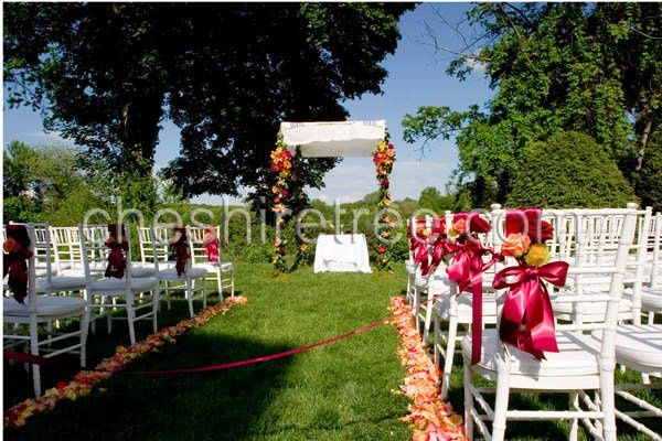 A traditional four pole chuppah with a cloth top set the scene for this ceremony at Crabtree's...