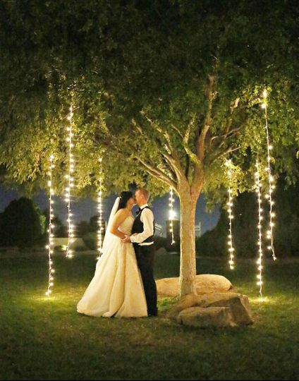 Magical lighting creates this enchanting space for the wedding couple.  Special twinkle lighting...