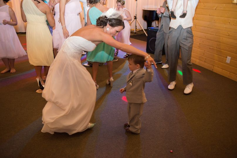 The bride and the little kid dancing