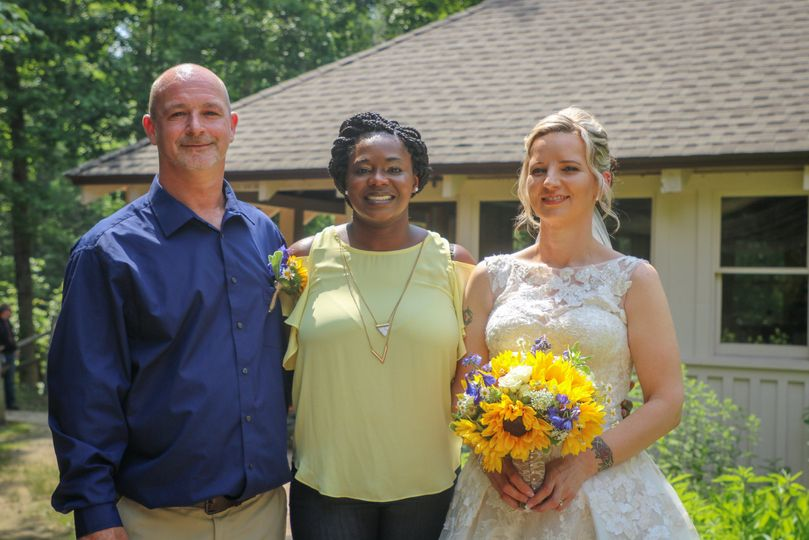 the officiant (me) and the lovely newly couple